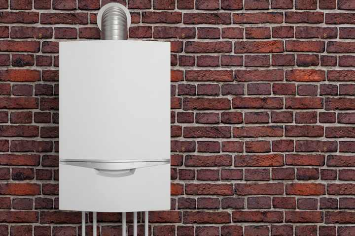 Boiler mounted on a brick wall.