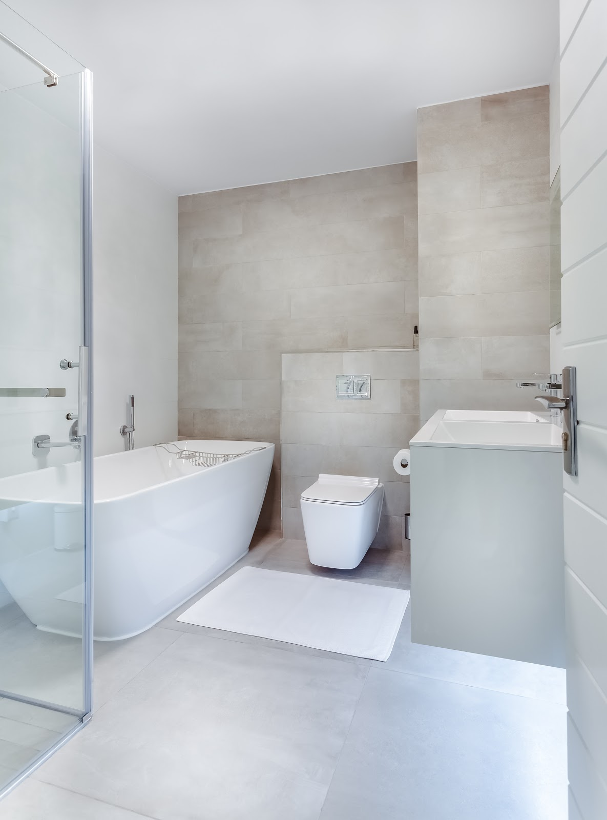 all-white bathroom with a large soaker tub.