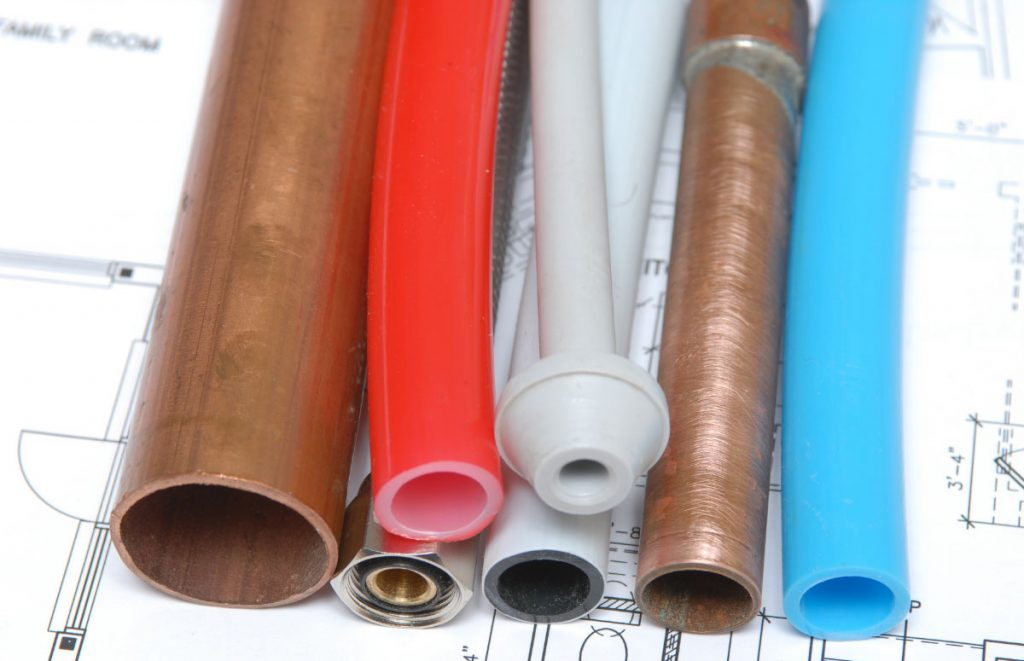 Plumbing pipes in a variety of materials and colours.
