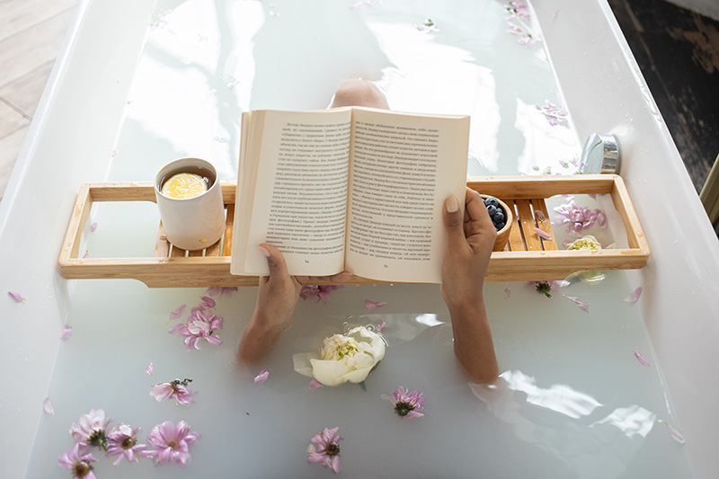 bathtub with person reading book